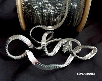 silver metallic sequin trim--stretch