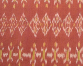 Hand-woven reddish-orange, yellow, 100%Cotton Ikat fabric by the yard