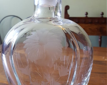 Etched glass wiskey decanter.