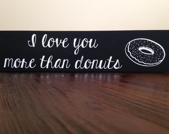 "3 1/2"" x 15"" ""I love you more than donuts"" black and white wood sign donut with sprinkles detail"