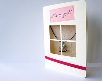 """Handmade It's a girl! greeting card with red """"rocking horse"""" keepsake jewellery piece"""