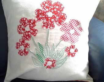 Red gingham applique flower pillow cover.
