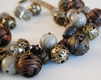 Mesh Balls with Snakeskin and Crystal Balls set on an Antique Gold Chain