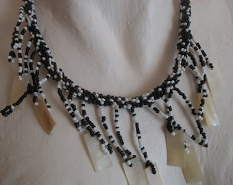 """vintage tiny black/white bead necklace 4 strand with 21 bead droplets 8 with MOP 18""""long black button fastening"""