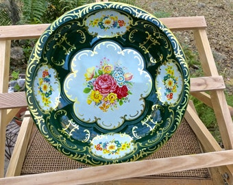 "Daher Decorated Ware 10"" round scalloped tray with a colorful floral pattern dated 1971"