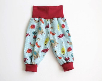 Baby harem pants. Mint bubble pants with little monsters and dots. Comfy slouchy infant pants with red fold over waistband and cuffs.