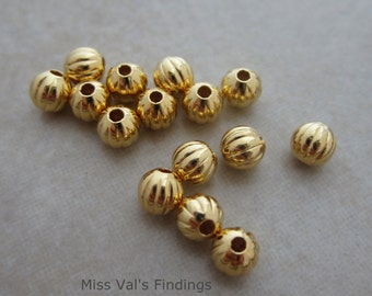 200 corrugated beads gold plated 4mm round