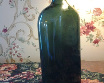 Antique green glass bottle