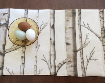 Placemats, in white brown and black, birch trees at night.Ten placemats.