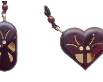 A modified Illusionist locket necklace pendant, made of natural wood all by hand,with a changeable shape of a heart or an oval by rotating.