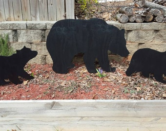 Yard shadow art silhouette Mama bear and cubs