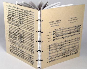 7x8.5 Musical Score-Covered Journal with your choice of pages. (Rite of Spring; Symphonies by Beethoven, Sibelius; Bach Signature)