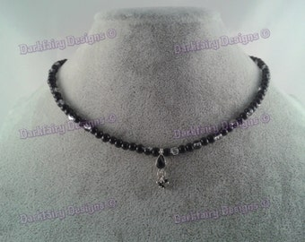 Beaded necklace with gem charm