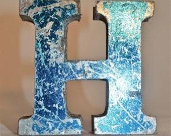 A fantastic vintage style metal 3D blue letter H