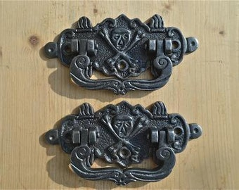 A pair of antique style cast iron skull and crossbones coffin handles WH3