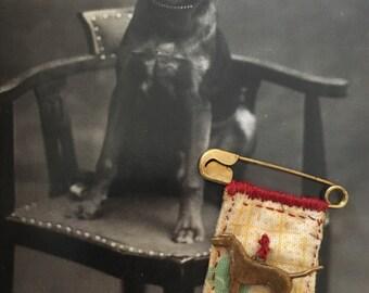 Hand-sewn vintage dog brooch