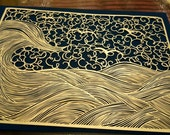 Beautiful intricate papercut, showing tumbling waves and clouds. Cut from a single sheet of A4 150 gsm shimmering yellow paper.