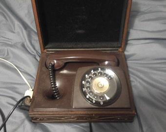 Vintage 1970's executive hidden phone in decorative wooden box.