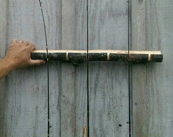 Rustic fishing pole holder