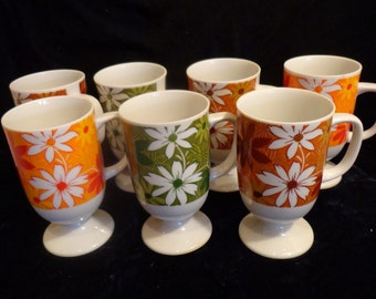 Flower Power 70s Daisy Pedestal Mugs, Set of 7 70s Psycheldelic Mugs with 70s Green, Orange and Brown Tones, Mod Daisies Cups