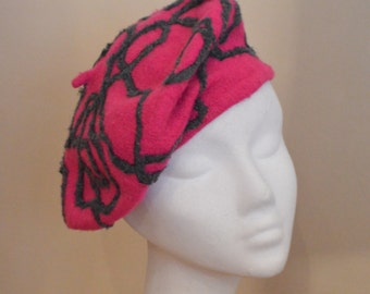 Bright pink beret with grey trim