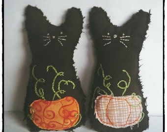 Halloween pumpkin embroidered black cat plush. Not a toy.