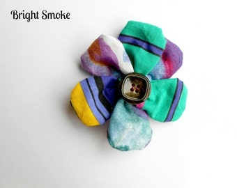 Floral fabric brooch with button centre and pin back. (FB10)