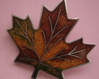 B592) A vintage silver tone metal Bond Boyd enamel Canadian maple leaf brooch.