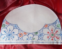 A vintage hand embroidered and hand made linen tea cosy or tea pot cover. May also be a kitchen appliance dust cover.