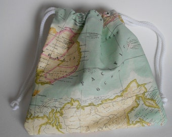 Pouch-sized drawstring bag in teflon-coated world map fabric