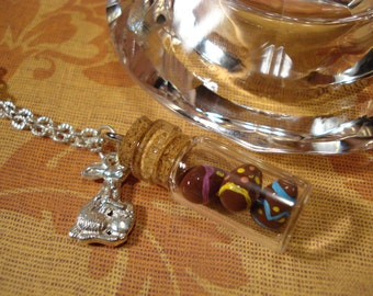 Chocolate eggs in a bottle necklace