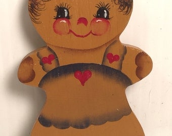 Small wooden gingerbread figure.