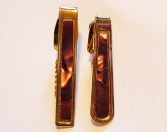A Set of Two 1970s Tie Clips