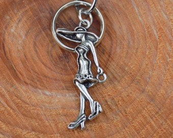 Key ring with elegant lady charm