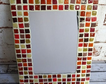 Mirror with mosaic in tones warm