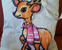 Bambi reworked tote bag . . Reversed aplique with free bambi brooch.