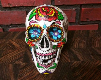 Sugar skull hand painted colorful Halloween decoration, dia del muertos, plastic hand painted skull, half life size, with crystals.