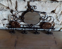 Wrought iron coat / hat rack with mirror and copper engravings circa 1970s.