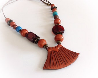 Ethnic necklace, asymmetrical, bib, copper, turquoise, polymer clay.