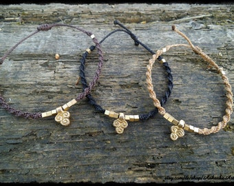 Macrame bracelet with brass beads and brass pendant