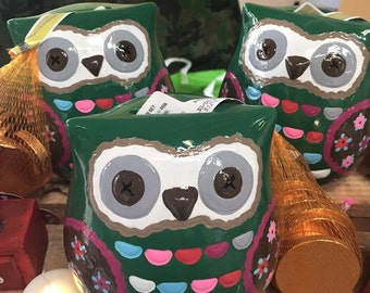 Owl money box with chocolate coins