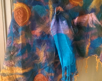 Wool felted onto wool in turquoise and oranges