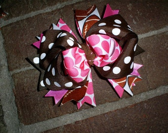 Football Boutique Hair Bow on an alligator clip in pink and brown dot