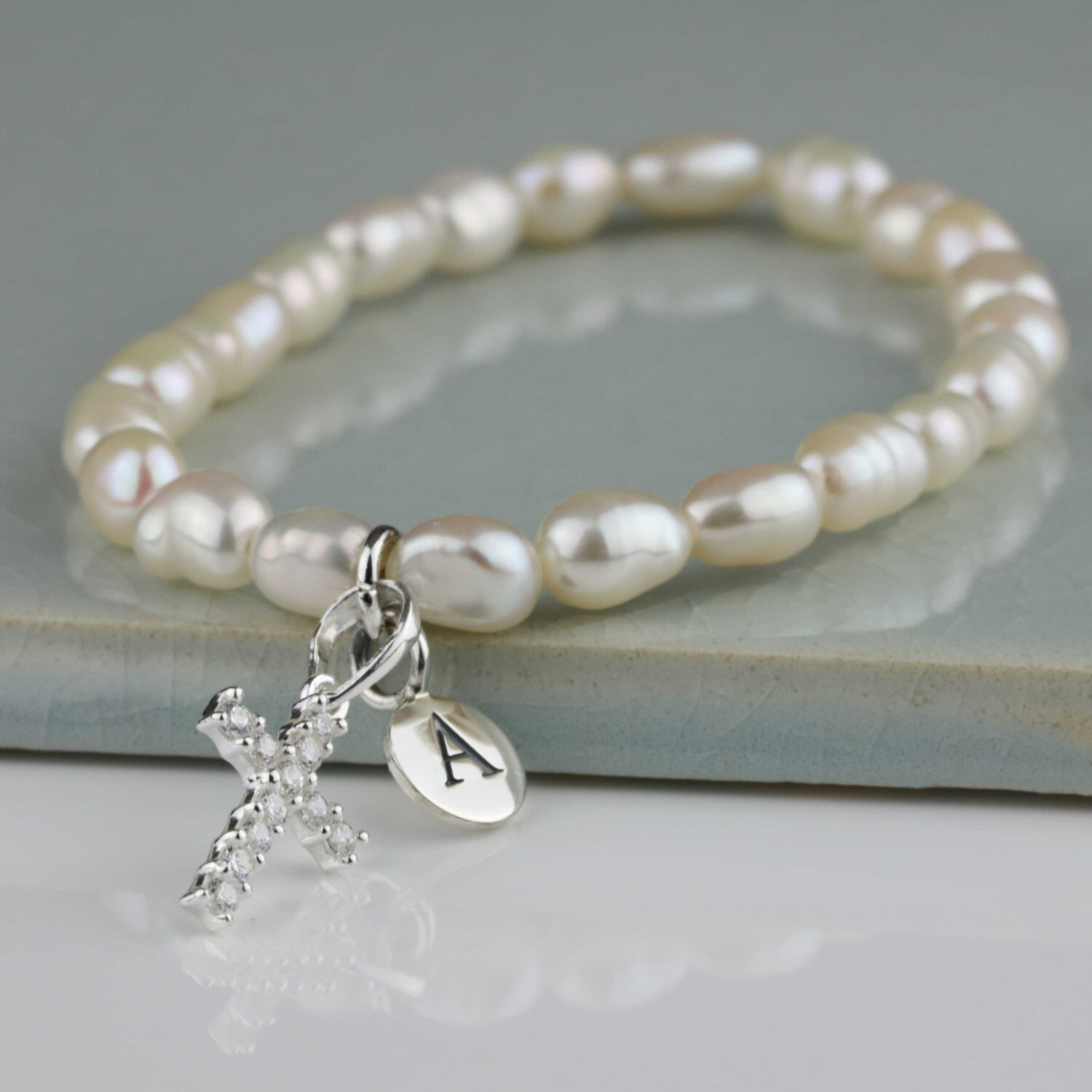 freshwater pearl bracelet with a solid silver cross charm