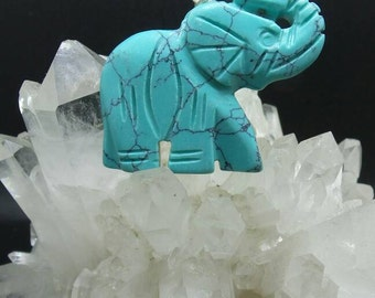 Hand Carved Turquoise Elephant Pendant.