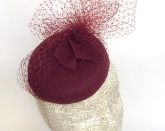red felt pillbox hat with red veiling