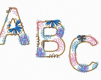 An alphabet embroidery flourished in applied 4 x 4 format