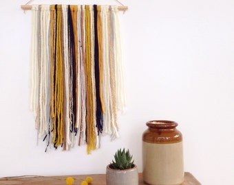 Wall hanging in navy and mustard yellow