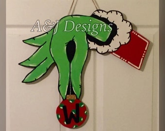 Door Hanger - Wood Cut Out - Christmas Grinch. This adorable Christmas Grinch Hand with Ornament can be changed to better meet your style!