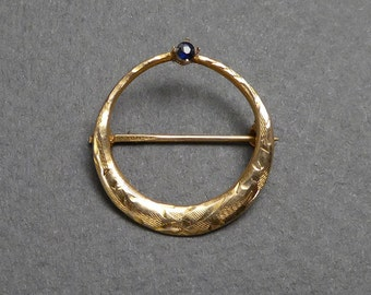 10 k sapphire round brooch